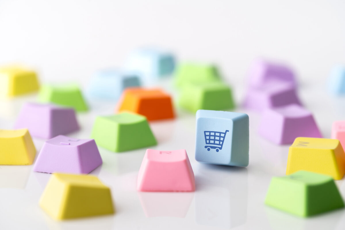 Business, marketing & online shopping strategy concept icon on the colorful computer keyboard